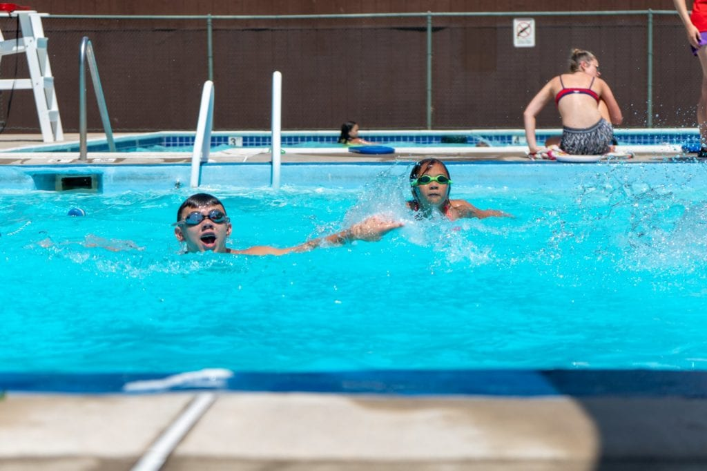 children swimming at camp riverbend